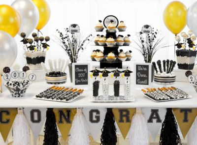 classy grad treat table ideas say you did it with a celebratory buffet of cupcakes candy and more