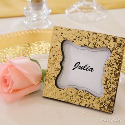 frame place cards in sparkling gold these golden glimmer frames make fetching favors